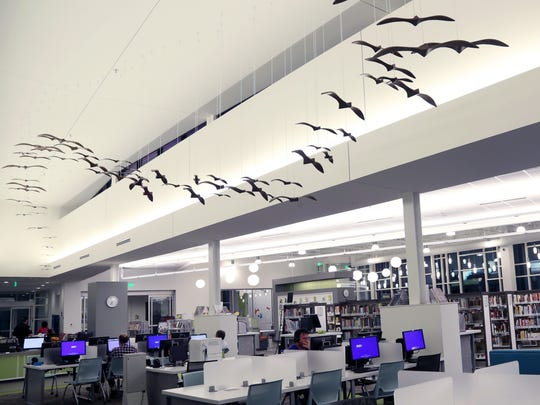 At the library in Bellevue, wooden birds suspended from the ceiling were made from a tree that was cut down during the construction of the building. The Bellevue branch is among the newest libraries in Nashville.