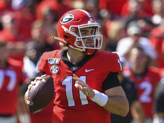 Oct 12, 2019; Athens, GA, USA; Georgia Bulldogs quarterback Jake Fromm (11) looks downfield to pass against the South Carolina Gamecocks during the first quarter at Sanford Stadium. Mandatory Credit: Dale Zanine-USA TODAY Sports ORG XMIT: USATSI-404196 ORIG FILE ID:  20191012_jla_sz2_039.jpg