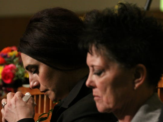 Julie Benner, back, widow of fallen officer Gregg Benner,