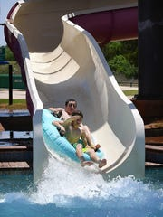 Waylon Elms and Austin Hammonds prepare for splashdown while riding the Cyclone slide at Castaway Cove Friday afternoon.