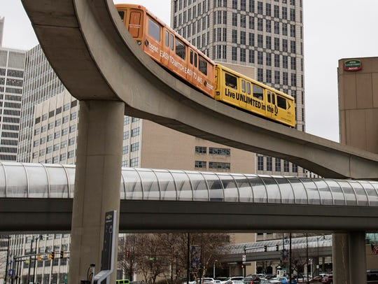 The Detroit People Mover moves toward the Millender