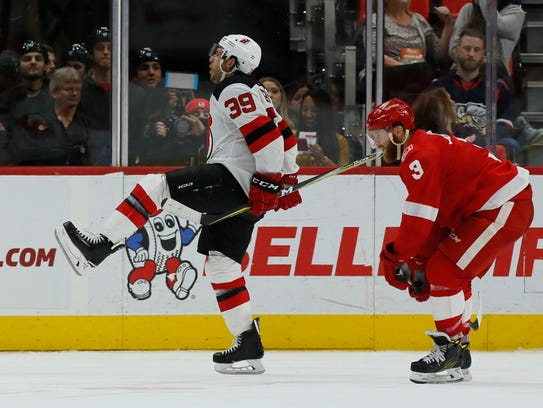New Jersey Devils left wing Brian Gibbons (39) celebrates
