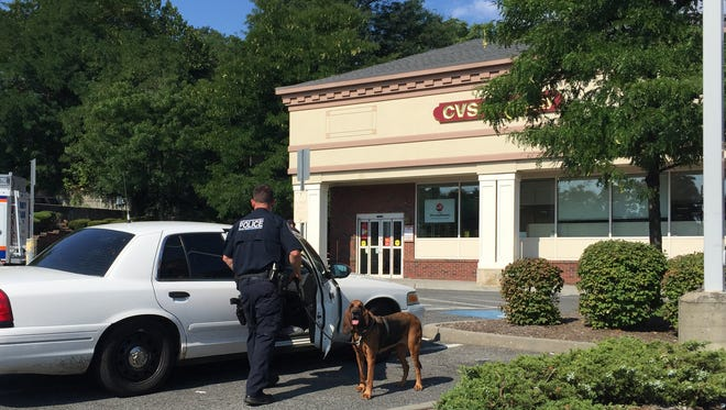 A Westchester County Police K-9 unit assisted the robbery investigation at the CVS store in Scarsdale.