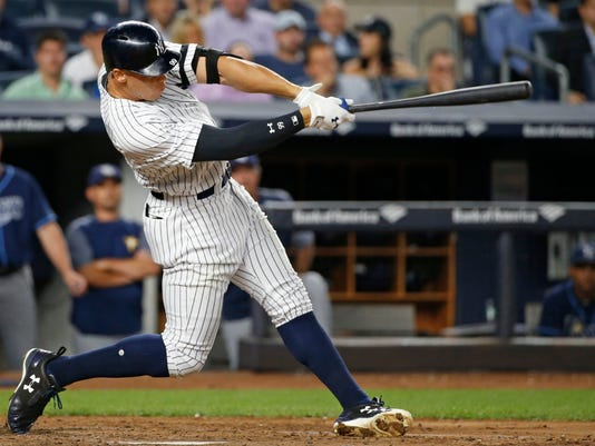 New York Yankees designated hitter Aaron Judge hits a two-run double during the fifth inning of a baseball game against the Tampa Bay Rays in New York, Wednesday, Sept. 27, 2017. (AP Photo/Kathy Willens)