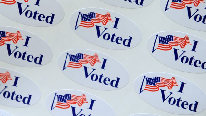 """I voted"" stickers await voters."