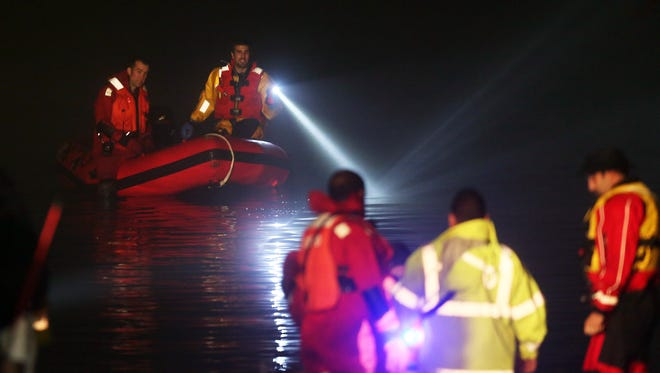 Croton Falls and Yorktown firefighters search for a missing plane in the dark waters of Titicus Reservoir in North Salem Nov 20, 2015. The plane was on its way to Danbury Airport when it went missing.