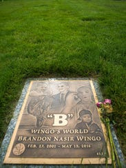 The grave stone of Brandon Wingo rests at Gracelawn