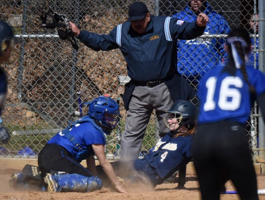 Gabby Marchisin slides in safely to home in the fourth