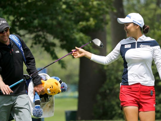 So Yeon Ryu of South Korea hands her driver back to caddie Tom Watson during a practice round of the 2017 Women's PGA Championship golf tournament at the Olympia Fields Country Club Wednesday, June 28, 2017, in Olympia Fields, Ill. (AP Photo/Charles Rex Arbogast)
