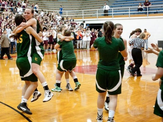 York Catholic celebrates its 60-37 win over Montrose on Tuesday in a PIAA Class AA semifinal at Martz Hall.