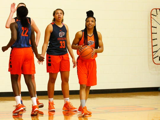 UTEP junior guard Jenzel Nash, right, is all smiles knowing that she and the Miners will get the opportunity to play at least one more game Thursday night. The Miners face Abilene Christian in the WNIT. Nash and her teammates Daeshianna McCants (33) and Jessica Barbosa (22) practiced Tuesday afternoon.
