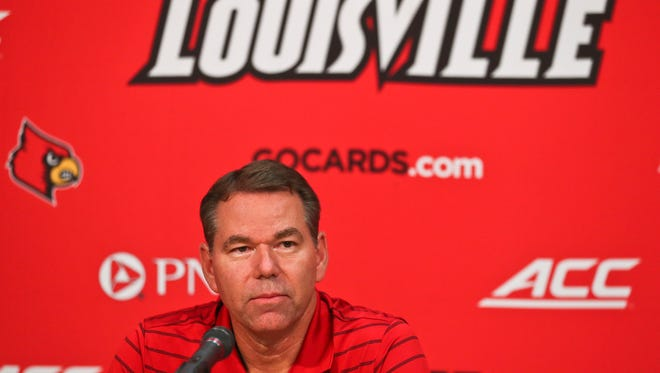 """Vince Tyra, interim athletic director for Louisville, said """"I don't buy it"""" that UofL coaches will want to leave after Tom Jurich's firing. Tyra spoke Thursday afternoon after David Padgett announced Greg Paulus' hiring."""