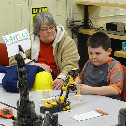 Colton Fleming, 6, of Coshocton, tries to pick up blocks