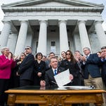 Gov. Scott signs VT gun bills, calling for civility, as protesters yell 'traitor'