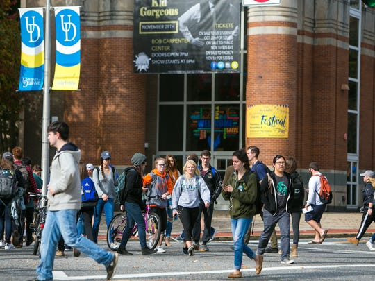 Students cross near the Trabant Center heading to their classes at University of Delaware in this file photo.