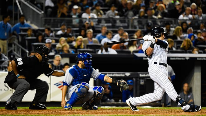 Jacoby Ellsbury of the Yankees hits a home run in the third inning during a game against the Toronto Blue Jays on September 19, 2014. The Yankees will rely on Ellsbury to generate offense in 2015.