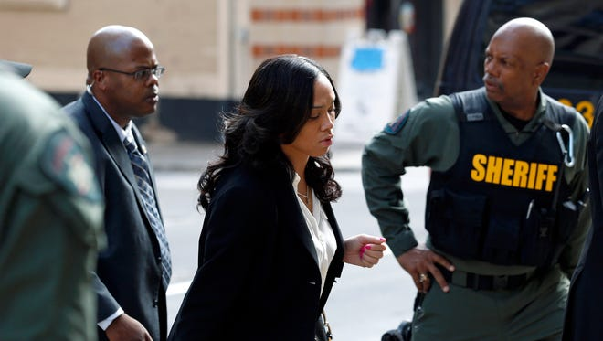 Baltimore state's attorney Marilyn Mosby, center, arrives at a courthouse before opening statements in the trial of Lt. Brian Rice, one of six members of the Baltimore Police Department charged in connection to the death of Freddie Gray, in Baltimore, Thursday.