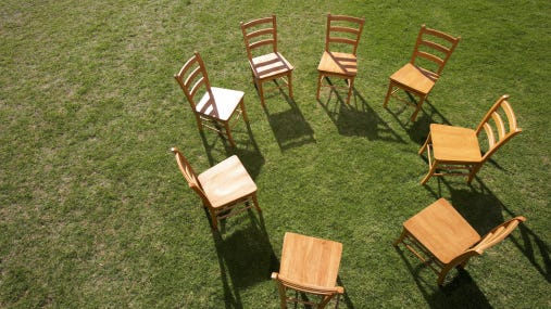 Chairs on lawn forming circle