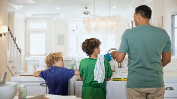 To help minimize your child's attention-seeking behavior, involve them more in daily activities, like washing the dishes.