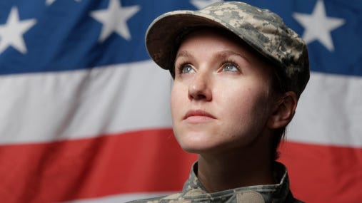Female soldier in front of U.S. flag