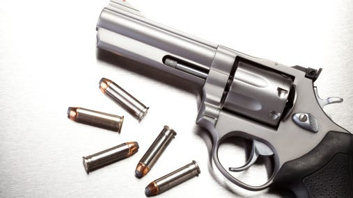 A Salem man is charged with gun possession -- a charge his lawyer finds unnecessary since his client can't use his arms.