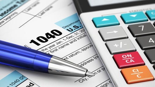 Federal income tax return From 1040 with pen and calculator