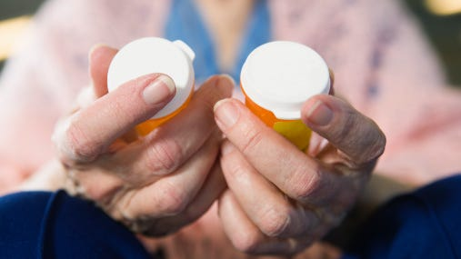 Senior woman holding medicines.