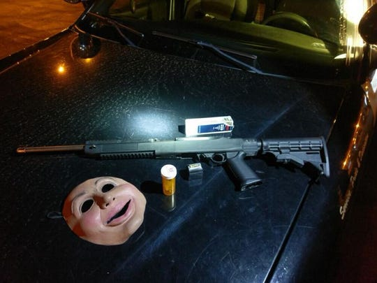 Salinas police seized a mask, loaded gun and heroin during an arrest on Saturday night.
