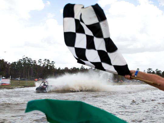 Thunder crosses the finish line during the Swamp Buggy