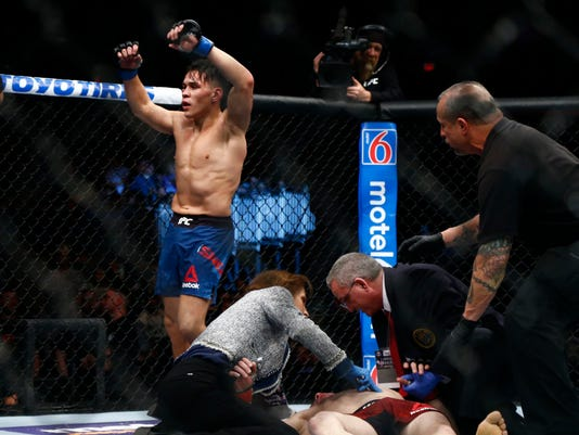 Fighter Ricky Simon wins by TKO after final bell at UFC Fight Night 128