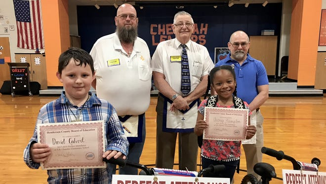 Masons, from left, Mike Austin, John Tucker and Dale Fritts pose with the perfect attendance bike winners at A.B. Chandler Elementary recently.