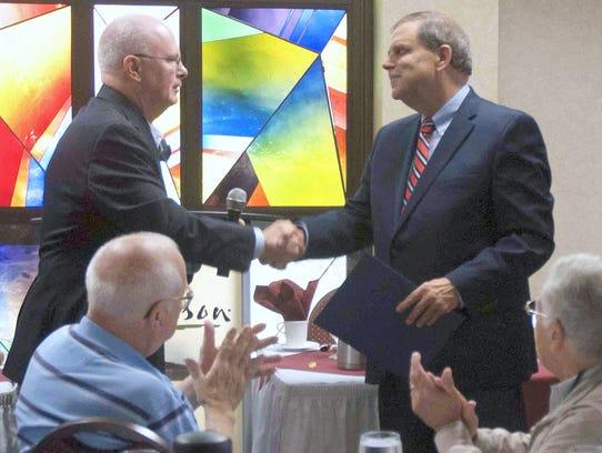 Corning Mayor Bill Boland, left, presents Charlie Craig