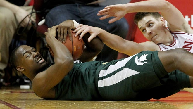 Joshua Langford (1) of the Michigan State Spartans and Zach McRoberts (15) of the Indiana Hoosiers battle for a loose ball in the first half Saturday at Assembly Hall.