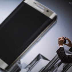 A woman takes a photo of the new Galaxy S6 during the Mobile World Congress in Barcelona, Spain.