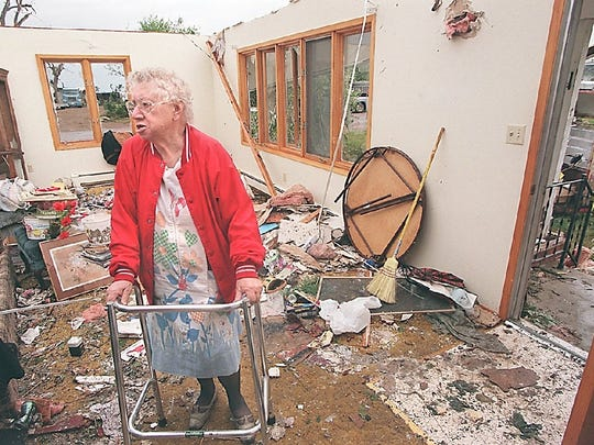 Amanda Stevens, 85, looks through her Spencer home for any salvageable belongings. Stevens saw the tornado out her kitchen window and just made it to her basement when the windows blew out.