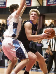 RFH's Ian O'Connor goes to the hoop.  Rumson-Fair Haven