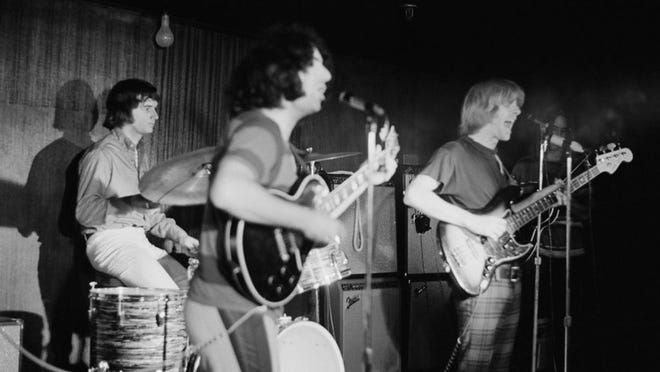 American rock band The Grateful Dead in concert, circa 1970. From left to right, drummer Bill Kreutzmann, lead singer Jerry Garcia and bassist Phil Lesh.