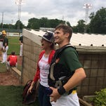 Dusty Thompson, left, proposed to Kristen Bogue after Bogue threw out the ceremonial first pitch before Saturday's Richmond RiverRats game at McBride Stadium.