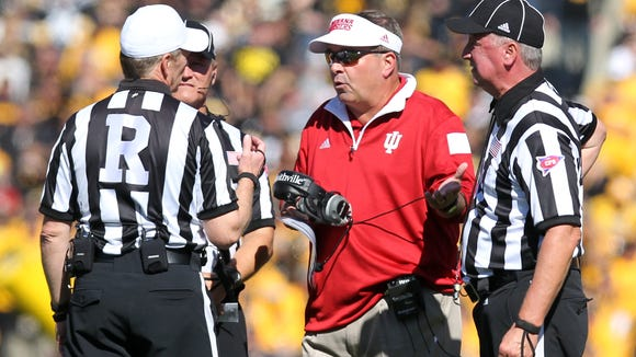 Indiana Hoosiers head coach Kevin Wilson talks with officials during their game with the Iowa Hawkeyes at Kinnick Stadium.