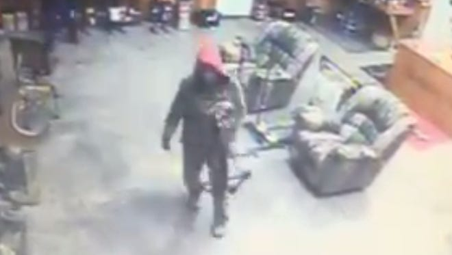 Still from surveillance video of one of the people suspected of a burglary at the Archery Den in Franklin Saturday, Feb. 13.