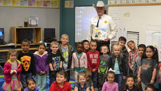 Tom Green County Sheriff David Jones paid a friendly visit to Stacey Miles and Sandra Jackson's Pre-K classes at Alta Loma Elementary recently.