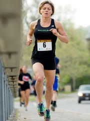 Rhonda Bullard of Danby runs to first place overall