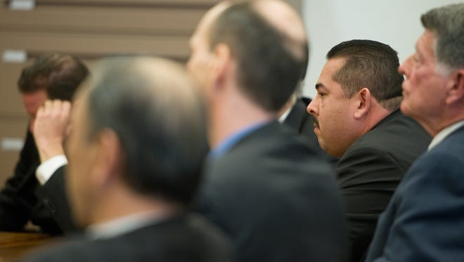 Two former Fullerton, Calif., police officers, Jay Cicinelli, left,  and  Manuel Ramos, right, were acquitted  Monday in Santa Ana, Calif.,  of all charges stemming from the death of transient Kelly Thomas, who died five days after his 2011 arrest at the Fullerton Transportation Center.