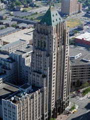 Aerial View of the Fisher building in Detroit in June 2012. Designed by Albert Kahn, the iconic tower initially was supposed to be just one of three in the complex but the Great Depression killed the other two.