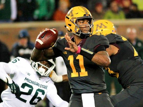 Minnesota quarterback Demry Croft (11) looks to pass