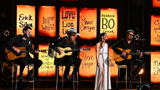 Brothers Osborne, Maren Morris and Eric Church perform 'Tears in Heaven' at the 60th Annual Grammy Awards at Madison Square Garden.