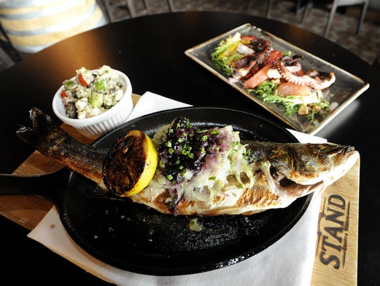 The roasted branzino, on the dinner menu, is made with