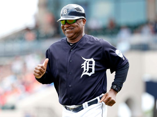 Tigers third base coach Dave Clark (25) trots to his