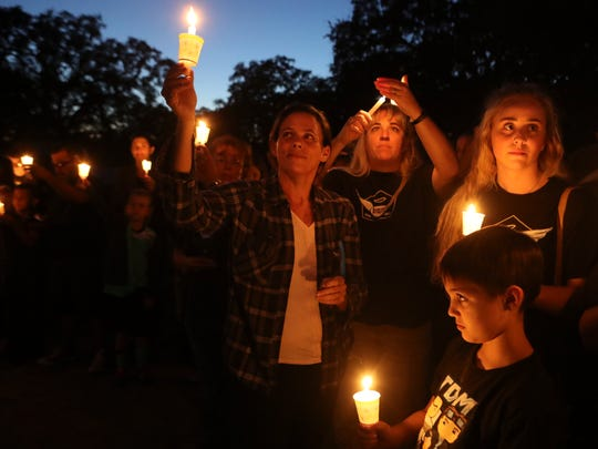 More than 400 people attend a welcoming-home candlelight ceremony Thursday night at the Red Bluff Little League field in remembrance of Auston Strole, a 12-year-old Little League player who died in July in a boating accident at Lake Shasta.