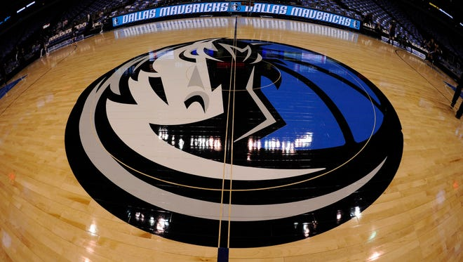 A general view of the Dallas Mavericks logo at center court before the game between the Mavericks and the Sacramento Kings at the American Airlines Center.